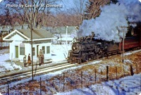 Engine 3676 has a Boston-bound train at Pierces Bridge Station, which was near Maple Street in Lexington, on March 13, 1954