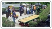 A restored antique baggage cart was unveiled at Bedford Depot Park on May 19, 2014.